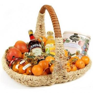 P8 CAMPARI, ORANGE JUICE, FRUIT TEA, AVOCADOS, ORANGES, CANDY, BASKET